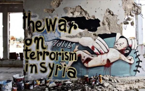 الحكاية بريشة رسام سوري.. رسائل الحب والحرب على جدران إدلب المدمرة