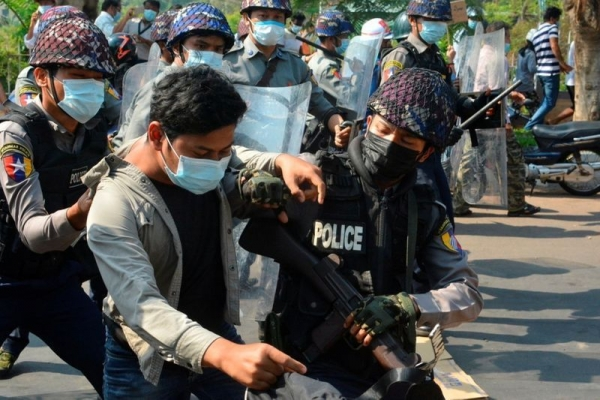 Myanmar army suspends laws limiting forces, hunts protest backers