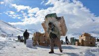 حمالون على الحدود العراقية الإيرانية.. لقمة ممزوجة بالثلج والدم