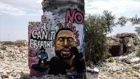 بغرافيتي على جدار قصفه النظام.. فنان سوري يخلد الأمريكي فلويد